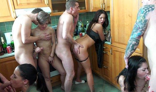 In the kitchen a crowd of lecherous Swingers entertains each other Org...