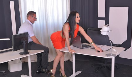 Busty Secretary fucked by boss right in the office...