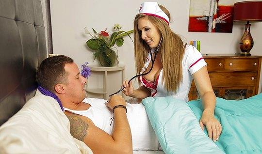Brunette in nurse uniform gave a muscular guy on bed...