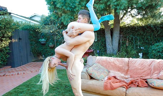 Young blonde outdoors on her knees makes a guy a deep Blowjob