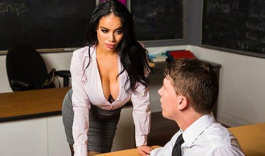 Busty brunette in stockings on the teachers Desk, spread her legs in f...