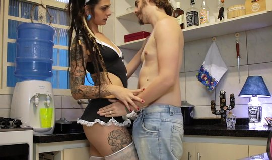 Young girlfriend with a tattoo on the body satisfies the guy sex in th...