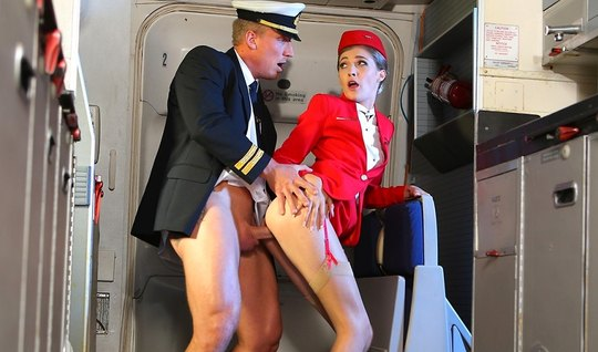 Beauty stewardess during the flight, gets fucked with the second pilot...