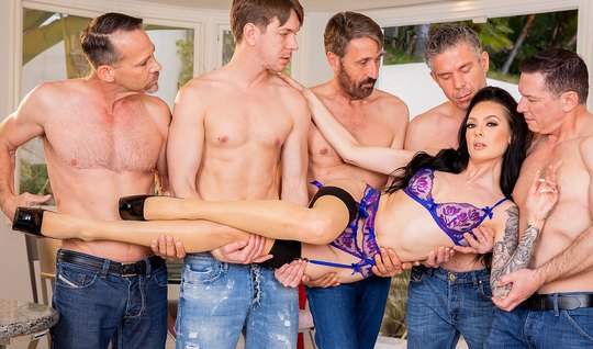 A crowd of men entertain the beauty of Gangbang and double penetration...