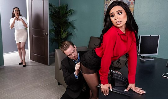 The Secretary in the office spread her legs in stockings and framed pu...