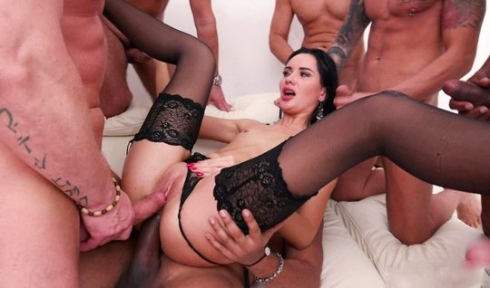 Brunette in stockings during Threesome orgasm from double penetration