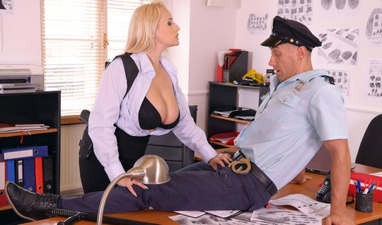 Woman with big milkings in the office saddled the member of the police...