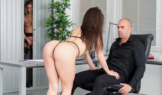 In the office, a bald man in society entertains a juicy brunette in st...