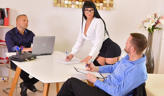In the office Busty brunette enjoys double penetration