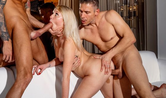 Young blonde takes part in group sex and cums while whipping...