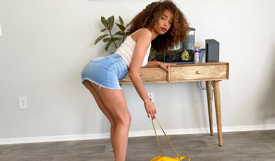 Curly-haired mulatto takes off her denim skirt and takes a long cock i...