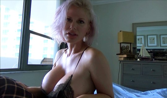 A mature aunt lifts up her dress, showing a shaved vagina and large mi...
