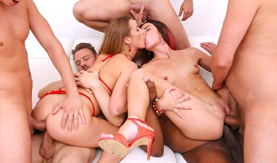 Girlfriends in an orgy double penetration with a crowd of muscular fir...