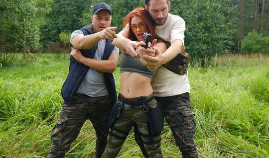 Redhead in nature with two hunters fucks cancer on green grass and cum...