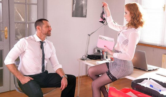Redhead secretary in the office pounces on the boss's juicy cock a...