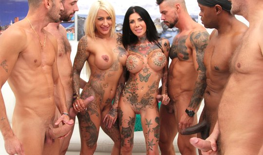 Tattooed girls came to the motorcycle club for a hot group sex with hu...